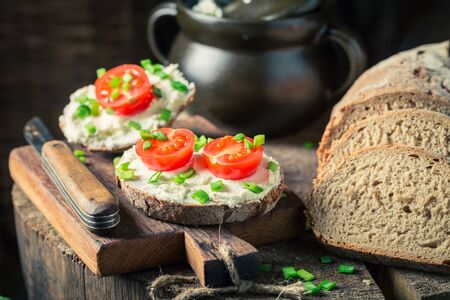Sandwich with fromage cheese, chive and cherry tomatoes Stock Photo