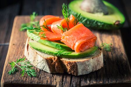 Closeup of sandwich with avocado, salmon and dill Stok Fotoğraf