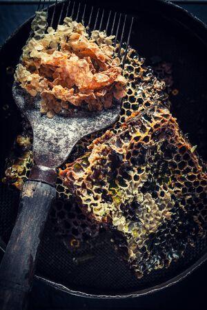 Age beekeeper tools in rustic wooden workshop