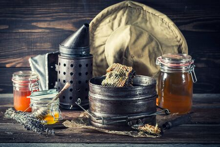 Rusty tools for beekeeping with fresh and sweet honey