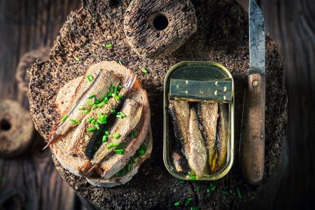 Top view of sandwich with sprats and wholegrain bread