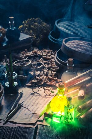 Old scrolls and recipe in magical alchemist laboratory Stock Photo