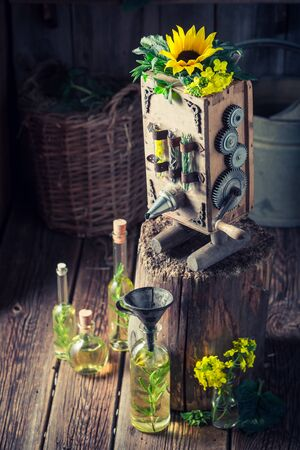 Homemade machine to make oil in old basement Фото со стока