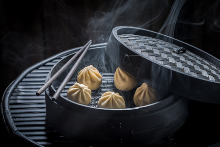 Closeup of chinese dumplings on black background
