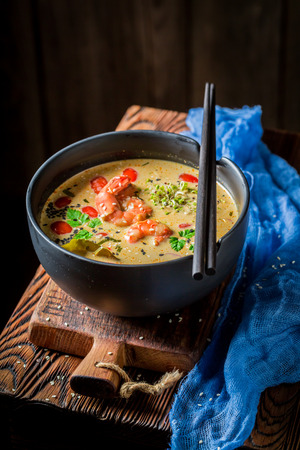 Tom Yum soup with shrimps on dark background