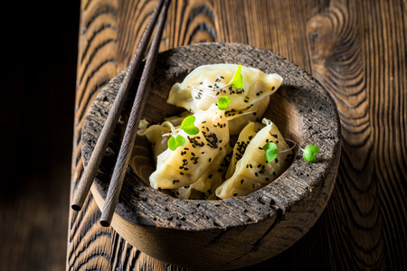 Closeup of chinese dumplings in wooden bowl