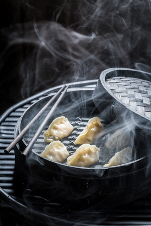 Closeup of chinese dumplings in bamboo steamer
