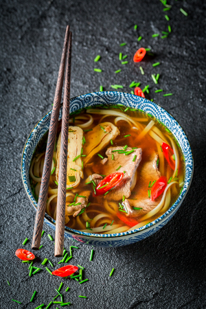 Hot Thai broth with beef and noodle on black rock Stok Fotoğraf