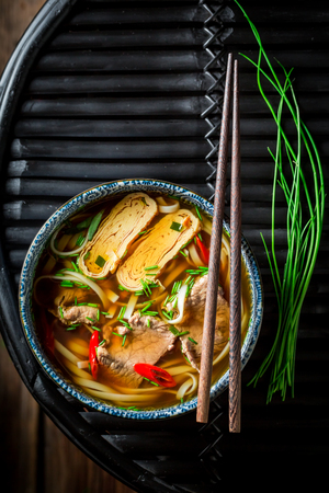 Hot Red Curry soup with beef on dark table Stok Fotoğraf
