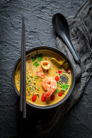 Closeup of Tom Yum soup on black rock Stock Photo