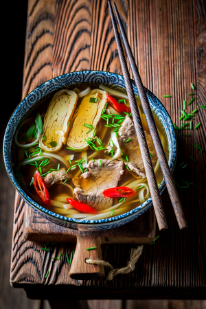 Closeup of delicious Red Curry soup with beef and noodle
