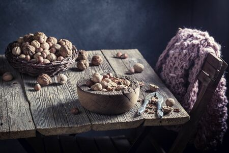 Fresh various nuts with on rustic wooden table