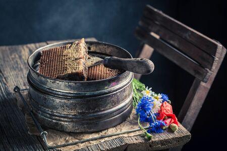 Vintage tools for beekeeping in workshop with honey