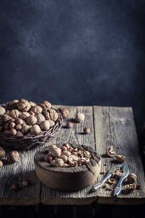 Delicious walnuts and hazelnuts with on rustic wooden table