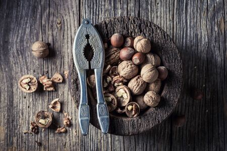 Fresh walnuts and hazelnuts with on rustic wooden table