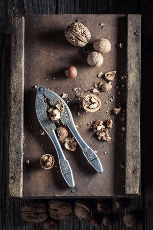 Healthy walnuts and hazelnuts with on rustic wooden table Stock Photo