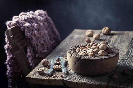 hazelnuts: Healthy walnuts and hazelnuts with with old nutcracker Stock Photo