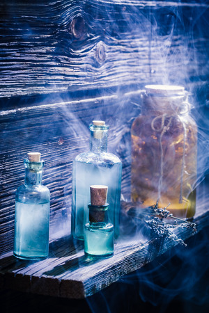 Old hut full of potion on wooden shelf for Halloween