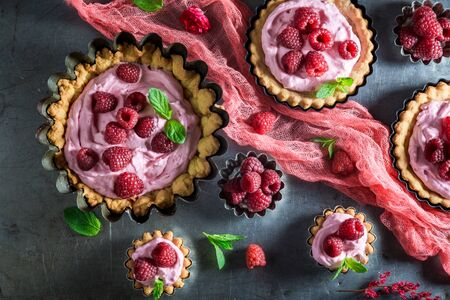 Homemade and sweet tarts with raspberries and mascarpone