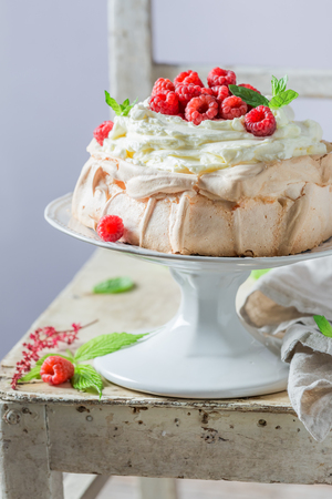 Sweet and creamy Pavlova dessert made of mascarpone and berries