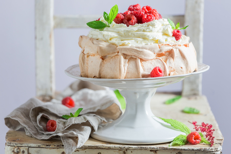 Homemade and rustic Pavlova dessert with berries and meringue