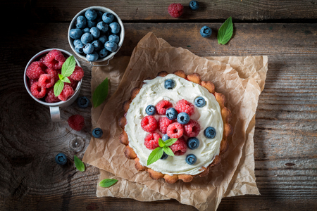 Sweet and creamy tart with blueberries and raspberries