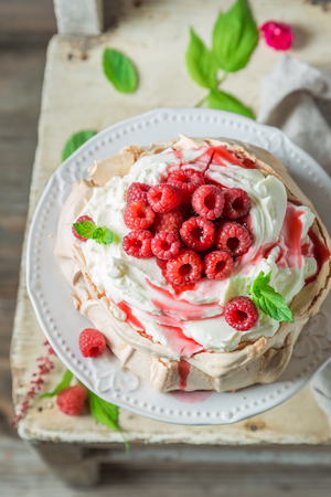 Sweet and creamy Pavlova cake made of mascarpone and berries