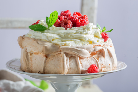 Delicious and crispy Pavlova cake with raspberries and meringue