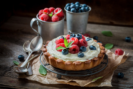 Tasty and aromatic tart with mascarpone cheese and fruit Stock Photo