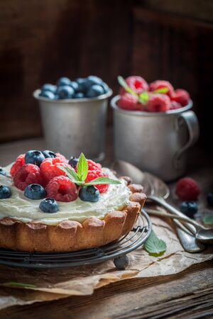 Homemade and rustic tart with berries and mascarpone