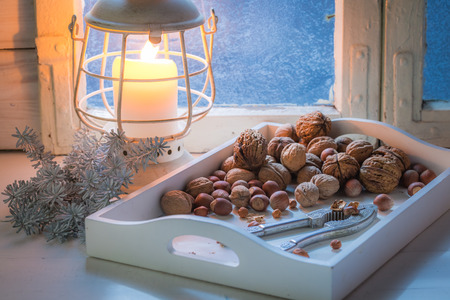 Tasty walnuts and hazelnuts for Christmas in cold night Stock Photo