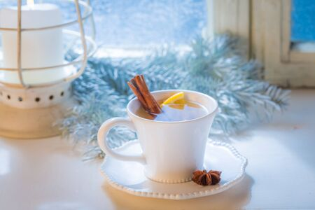 Hot and sweet tea with cinnamon and orange for Christmas Stock Photo