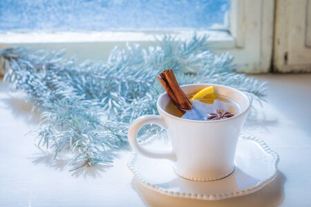 Tasty and sweet tea with cinnamon and orange for Christmas