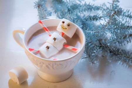 Closeup of funny snowman for Christmas in hot chocolate