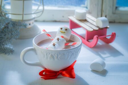 Relaxing in hot cocoa snowman for Christmas and sleigh