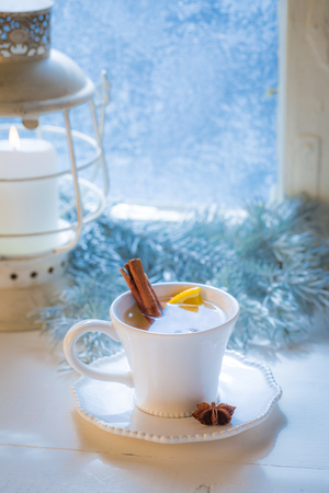 Sweet and hot tea with orange and cinnamon for Christmas
