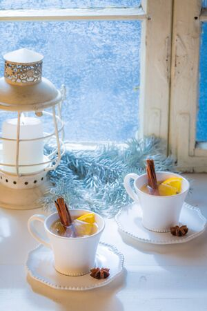 Sweet and hot tea with cinnamon and orange for Christmas