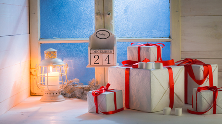 Gifts for Christmas with a blue window and white table