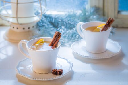 Hot and aromatic tea with orange and cinnamon for Christmas