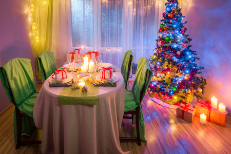 Family Christmas table setting with candles and gingerbread