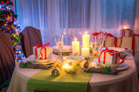 Gorgeous Christmas table setting with candles and gingerbread Stock Photo