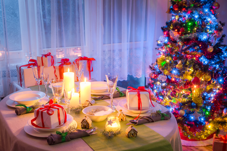 Enjoy you Christmas table setting with present and tree Stock Photo