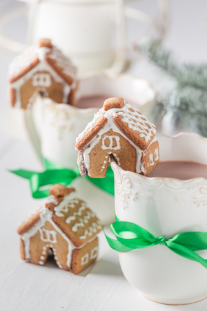 Closeup of gingerbread cottages with tasty cocoa for Christmas Stock Photo