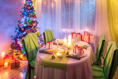 Breathtaking Christmas table setting during the frosty winter evening Stock Photo