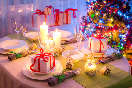 Breathtaking Christmas table setting with green and white decoration Stock Photo