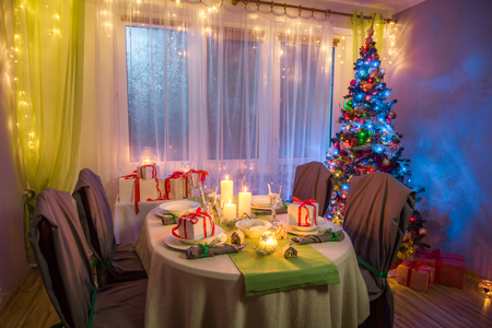 Traditionally Christmas table setting during the frosty winter evening