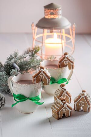 Homemade gingerbread cottages with tasty cocoa in Christmas winter evening Stock Photo