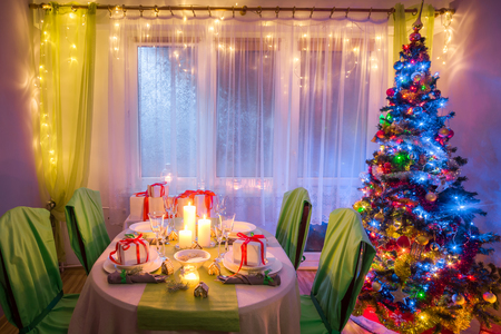 Breathtaking Christmas table setting with candles and gingerbread