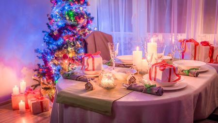 Gorgeous Christmas table setting with tree and present