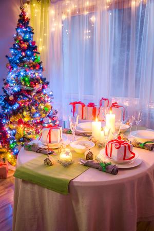 Moody Christmas table setting for Christmas eve Stock Photo
